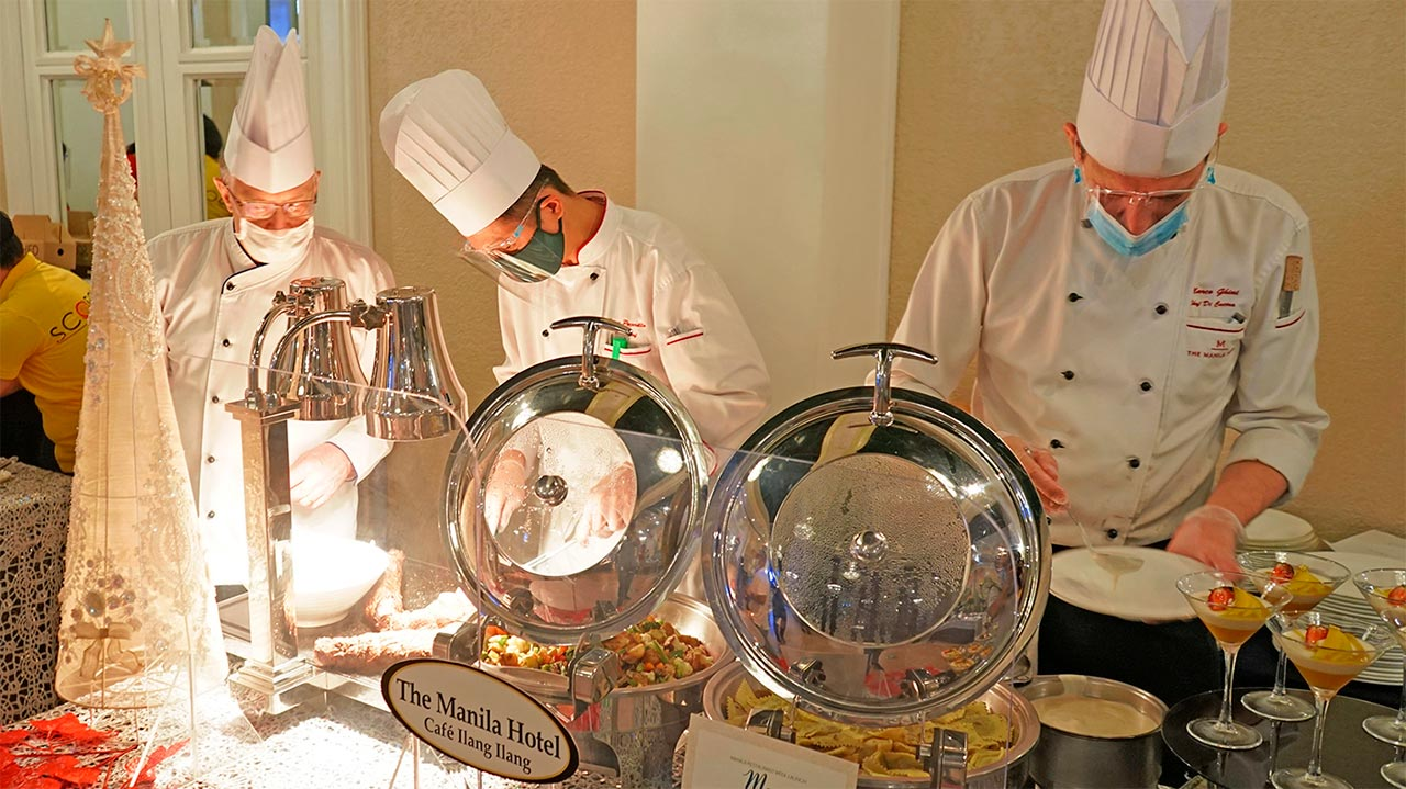 Cafe Ilang Ilang chefs led by Executive Chef Konrad Walter (left) preparing the dishes showcased at the Manila Resturant Week launch held in Roma Salon at The Manila Hotel