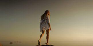 girl alone walking on rocks