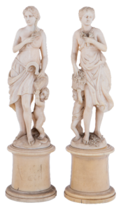 Lot 180: A pair of ivory sculptures depicting Greek goddesses Ceres and Chloris